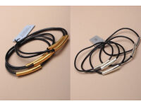 Card of 5 black gummy bracelets with gold or silver coloured tube detail. - JTY097