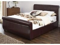 Double bed - Leather frame. Used once and like new! Upholstered in black leather.