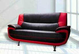 Red and black faux leather sofa