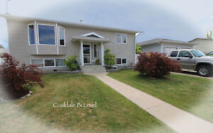 COALDALE HOME WITH LARGE GARAGE & RV PARKING!