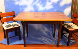 CHILD'S HARVEST STYLE TABLE AND TWO CHAIRS