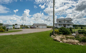 2.87 Acres 10 Minutes East of Airdrie - Nice House and Garage