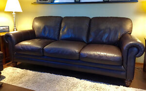 Natuzzi genuine leather couch and ottoman