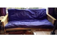 Futon. 3-seater / double-bed. 206/84/78cm. Well used, tiny scratches,but sound. Free if you collect