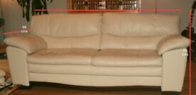 Christmas Lounge Luxury: Cream leather living room suite.