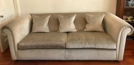 Two sofa's in very good condition with scatter cushions in silver velvet
