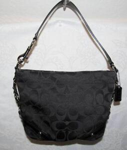 b6c0f820f5d9 Coach Black Signature Carly Handbag
