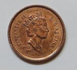 Canadian Penny 1952-2002 and another one dated 1867-1992