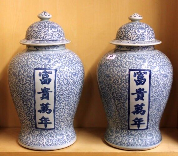 A pair of 19th / early 20th century Chinese porcelain jars and lids, H. 49cm