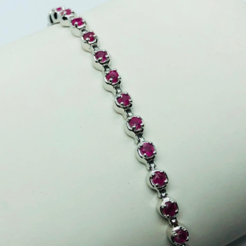 Silver Bracelet w/ 31 Round Mix Cut Ruby in Claws Setting $700 Appraisal