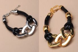 Black corded bracelet with large chain links. In either gold or silver colours - JTY073