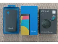 Mint condition unlocked LG Nexus 5 with Google case and Nexus 4 wireless charger
