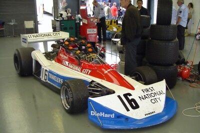 PHOTO  FRANK SYTNER IN HIS EX-JOHN WATSON F1 PENSKE PC3 AGAINST A PRETTY CLASSY