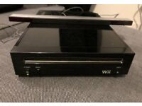 wii with controller, sensor bar, nunchuck and 1 game. comes with all wires. fully working order