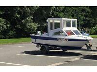 16ft fishing boat, 40hp Suzuki outboard, can sleep 2