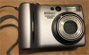Nikon Digital Cameras and a Panasonic Camcorder