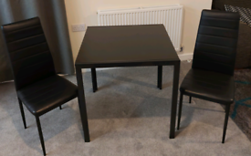 Table chairs coffee table and TV unit