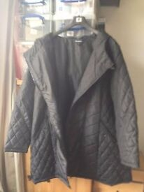 Black ASYMMETRIC QUILTED COAT - Brand New. (Size 20)