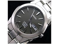 Seiko Sapphire Titanium 100m Watch, Brand new never worn still has factory seals.
