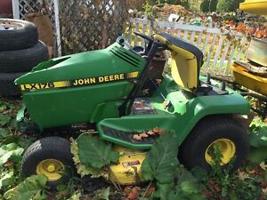 John Deere Tractor with Mower and Snow blower for sale
