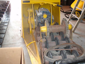 lOOKING.   For. Tin cab. Autobogan ect parts vintage snowmobile