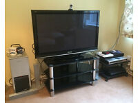 Brookside, Telford - 2 TV stands - one REAL WOOD and one is CHROME with GLASS shelves - see photos