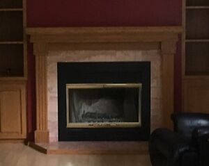 Wood burning fireplace with mantle