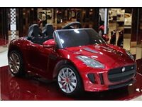 Licensed 12v Jaguar F type ride on car with remote control music and lights (leeds) only £200