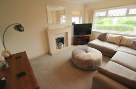 DFS dream corner sofa and matching footstool