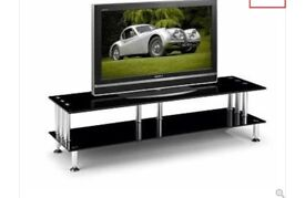 Black glass tv stand. In excellent condition. No marks or scratches.