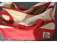 Red baby changing bag