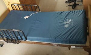 used electric hospital bed by invacare