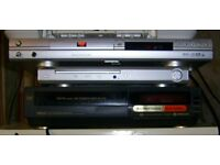 2 x DVD Players + 1 x Hitachi VHS Player For Spares With Remote Controls