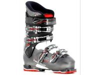 Skis, ski boots and helmet - as new condition