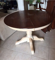 Round wooden table with two leafs