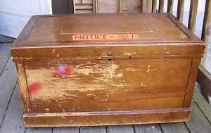 Large old wooden carpenters tool chest with shelves on castors