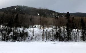 Chalet à louer bord de l'eau rivière Montmorency près de Québec