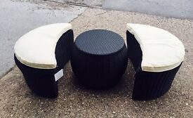 Rattan side table and 2 padded stools