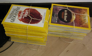 2 stacks of National Geographic magazines from 2007 - 2011