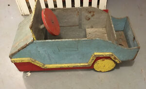 Antique wooden push car door opens for child to sit inside
