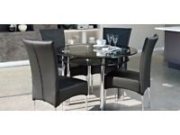 Harveys Glass Dining Table And Four Leather Chairs