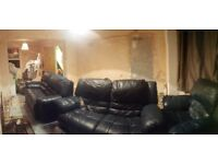 Two 2 seater sofas and armchair - all reclining