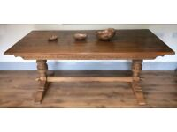 Oak Table with beautiful design and features. Very good condition,solid & sturdy.