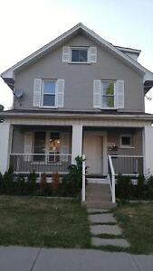 CENTRALLY LOCATED 2 BEDROOM 2 LEVEL MAIN FLOOR APARTMENT AT 2014