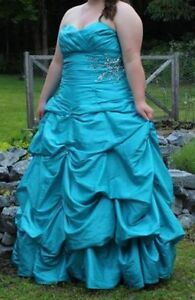Turquoise strapless prom dress with corset back