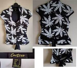 Women's top size 8. NEW! Black with silver marijuana leaves