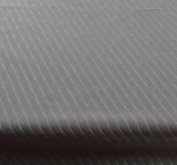 Holden VL Calais Sandalwood Diagonal Material NOS in a 7mx1.4m