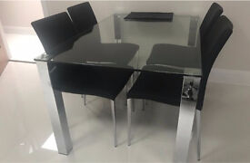 Mint Condition Glass Dining Room Table and 4Chairs