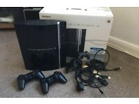 PlayStation 3 (in box, games and controllers)