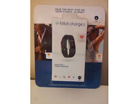 2 brand new, unopened Fit bit charge 2 Fitness smart watch for sale! !